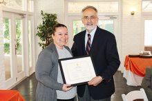 Alumni inductee Janet Brishke and PHHP Dean Michael Perri