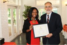 Alumni inductee Kendra Auguste and PHHP Dean Michael Perri